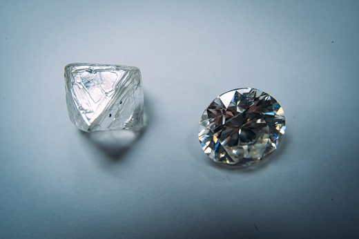 Rough and polished diamonds next to each other at De Beers